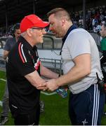 29 June 2019; Tyrone manager Mickey Harte, left, shakes hands with Kildare manager Cian O'Neill following the GAA Football All-Ireland Senior Championship Round 3 match between Kildare and Tyrone at St Conleth's Park in Newbridge, Co. Kildare. Photo by Ramsey Cardy/Sportsfile