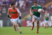 29 June 2019; Fionn McDonagh of Mayo in action against Aidan Forker of Armagh during the GAA Football All-Ireland Senior Championship Round 3 match between Mayo and Armagh at Elverys MacHale Park in Castlebar, Mayo. Photo by Ben McShane/Sportsfile