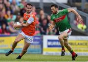 29 June 2019; Jamie Clarke of Armagh evades Chris Barrett of Mayo during the GAA Football All-Ireland Senior Championship Round 3 match between Mayo and Armagh at Elverys MacHale Park in Castlebar, Mayo. Photo by Ben McShane/Sportsfile