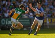 29 June 2019; Donal Kingston of Laois in action against Johnny Moloney of Offaly during the GAA Football All-Ireland Senior Championship Round 3 match between Laois and Offaly at O'Moore Park in Portlaoise, Laois. Photo by Eóin Noonan/Sportsfile