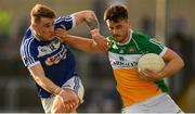 29 June 2019; Eoin Carroll of Offaly is tackled by Trevor Collins of Laois during the GAA Football All-Ireland Senior Championship Round 3 match between Laois and Offaly at O'Moore Park in Portlaoise, Laois. Photo by Eóin Noonan/Sportsfile
