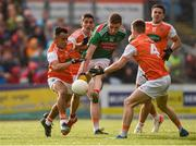 29 June 2019; Fionn McDonagh of Mayo in action against Jemar Hall, left, and Paul Hughes, 4, of Armagh during the GAA Football All-Ireland Senior Championship Round 3 match between Mayo and Armagh at Elverys MacHale Park in Castlebar, Mayo. Photo by Ben McShane/Sportsfile