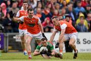 29 June 2019; Keith Higgins of Mayo is fouled by Brendan Donaghy, left, and Mark Shields of Armagh during the GAA Football All-Ireland Senior Championship Round 3 match between Mayo and Armagh at Elverys MacHale Park in Castlebar, Mayo. Photo by Ben McShane/Sportsfile