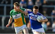 29 June 2019; Martin Scully of Laois in action against David Dempsey of Offaly during the GAA Football All-Ireland Senior Championship Round 3 match between Laois and Offaly at O'Moore Park in Portlaoise, Laois. Photo by Eóin Noonan/Sportsfile