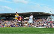 29 June 2019; David Tubridy of Clare shoots to score his side's first goal of the game despite the attentions of Boidu Sayeh and Eoin Carberry of Westmeath during the GAA Football All-Ireland Senior Championship Round 3 match between Westmeath and Clare at TEG Cusack Park in Mullingar, Westmeath. Photo by Sam Barnes/Sportsfile