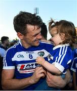 29 June 2019; John O'Loughlin of Laois with his goddaughter Lily Fitzgerald, age 1 following the GAA Football All-Ireland Senior Championship Round 3 match between Laois and Offaly at O'Moore Park in Portlaoise, Laois. Photo by Eóin Noonan/Sportsfile