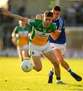 29 June 2019; Niiall McNamee of Offaly in action against Robert Pigott of Laois during the GAA Football All-Ireland Senior Championship Round 3 match between Laois and Offaly at O'Moore Park in Portlaoise, Laois. Photo by Eóin Noonan/Sportsfile