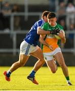 29 June 2019; Ruairi McNamee of Offaly is tackled by Gareth Dillon of Laois during the GAA Football All-Ireland Senior Championship Round 3 match between Laois and Offaly at O'Moore Park in Portlaoise, Laois. Photo by Eóin Noonan/Sportsfile