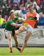 29 June 2019; Rian O'Neill of Armagh in action against Donal Vaughan of Mayo during the GAA Football All-Ireland Senior Championship Round 3 match between Mayo and Armagh at Elverys MacHale Park in Castlebar, Mayo. Photo by Brendan Moran/Sportsfile