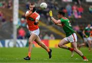 29 June 2019; Rian O'Neill of Armagh in action against Ciaran Tracey of Mayo during the GAA Football All-Ireland Senior Championship Round 3 match between Mayo and Armagh at Elverys MacHale Park in Castlebar, Mayo. Photo by Brendan Moran/Sportsfile