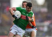29 June 2019; Brendan Harrison of Mayo is tackled by Jamie Clarke of Armagh during the GAA Football All-Ireland Senior Championship Round 3 match between Mayo and Armagh at Elverys MacHale Park in Castlebar, Mayo. Photo by Brendan Moran/Sportsfile