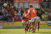 29 June 2019; Fionn McDonagh of Mayo kicks a point despite the attention of Jemar Hall, left, and Paul Hughes, 4, of Armagh during the GAA Football All-Ireland Senior Championship Round 3 match between Mayo and Armagh at Elverys MacHale Park in Castlebar, Mayo. Photo by Ben McShane/Sportsfile
