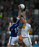 29 June 2019; Paddy Dunican of Offaly in action against Evan Carroll of Laois during the GAA Football All-Ireland Senior Championship Round 3 match between Laois and Offaly at O'Moore Park in Portlaoise, Laois. Photo by Eóin Noonan/Sportsfile