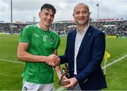 30 June 2019; John Kingston, ESB Manager, presents Cathal O'Neill of Limerick with the Player of the Match award for his major performance in the Electric Ireland GAA Munster Minor Hurling Championship Final. Throughout the Championships, fans can follow the conversation, vote for their player of the week, support the Minors and be a part of something major through the hashtag #GAAThisIsMajor. Electric Ireland Munster GAA Hurling Minor Championship Final match between Limerick and Clare at LIT Gaelic Grounds in Limerick. Photo by Brendan Moran/Sportsfile