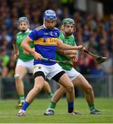 30 June 2019; John McGrath of Tipperary in action against Sean Finn of Limerick during the Munster GAA Hurling Senior Championship Final match between Limerick and Tipperary at LIT Gaelic Grounds in Limerick. Photo by Brendan Moran/Sportsfile