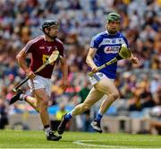 30 June 2019; Aaron Dunphy of Laois runs past Paul Greville of Westmeath on his way to scoring the second goal, in the 18th minute, of the Joe McDonagh Cup Final match between Laois and Westmeath at Croke Park in Dublin. Photo by Ray McManus/Sportsfile