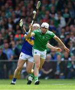 30 June 2019; Aaron Gillane of Limerick in action against Seán O'Brien of Tipperary during the Munster GAA Hurling Senior Championship Final match between Limerick and Tipperary at LIT Gaelic Grounds in Limerick. Photo by Piaras Ó Mídheach/Sportsfile