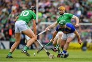 30 June 2019; John O'Dwyer of Tipperary is tackled by Gearoid Hegarty and Richie English of Limerick during the Munster GAA Hurling Senior Championship Final match between Limerick and Tipperary at LIT Gaelic Grounds in Limerick. Photo by Brendan Moran/Sportsfile