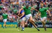 30 June 2019; John O'Dwyer of Tipperary is tackled by Gearoid Hegarty of Limerick during the Munster GAA Hurling Senior Championship Final match between Limerick and Tipperary at LIT Gaelic Grounds in Limerick. Photo by Brendan Moran/Sportsfile