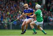 30 June 2019; Ronan Maher of Tipperary  in action against Cian Lynch of Limerick during the Munster GAA Hurling Senior Championship Final match between Limerick and Tipperary at LIT Gaelic Grounds in Limerick. Photo by Brendan Moran/Sportsfile