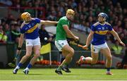 30 June 2019; Dan Morrissey of Limerick in action against Séamus Callanan and Jason Forde of Tipperary during the Munster GAA Hurling Senior Championship Final match between Limerick and Tipperary at LIT Gaelic Grounds in Limerick. Photo by Brendan Moran/Sportsfile