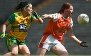30 June 2019; Geraldine McLaughlin of Donegal in action against Caoimhe Morgan of Armagh during the Ladies Football Ulster Senior Championship Final match between Armagh and Donegal at St Tiernach's Park in Clones, Monaghan. Photo by Ben McShane/Sportsfile