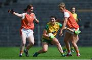 30 June 2019; Emer Gallagher of Donegal in action against Caoimhe Morgan, left, and Nicole McLaughlin of Donegal during the Ladies Football Ulster Senior Championship Final match between Armagh and Donegal at St Tiernach's Park in Clones, Monaghan. Photo by Ben McShane/Sportsfile