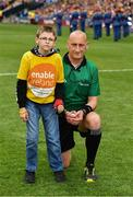 30 June 2019; Pictured is Brandon Burke with referee John Keenan, from Enable Ireland Children's Services presenting the match sliotar at Croke Park for the Leinster Championship Hurling Final 201. Enable Ireland are the official charity partner of the GAA. Photo by Ray McManus/Sportsfile *** NO REPRODUCTION FEE ***