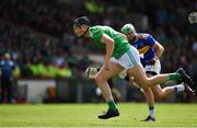 30 June 2019; Kyle Hayes of Limerick races clear of James Barry of Tipperary on the way to scoring his side's second goal during the Munster GAA Hurling Senior Championship Final match between Limerick and Tipperary at LIT Gaelic Grounds in Limerick. Photo by Brendan Moran/Sportsfile