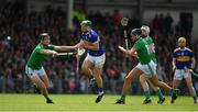 30 June 2019; Noel McGrath of Tipperary in action against Limerick players, from left, Kyle Hayes, Gearoid Hegarty and Cian Lynch during the Munster GAA Hurling Senior Championship Final match between Limerick and Tipperary at LIT Gaelic Grounds in Limerick. Photo by Brendan Moran/Sportsfile