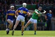 30 June 2019; Peter Casey of Limerick in action against Seán O'Brien and Padraic Maher of Tipperary during the Munster GAA Hurling Senior Championship Final match between Limerick and Tipperary at LIT Gaelic Grounds in Limerick. Photo by Brendan Moran/Sportsfile