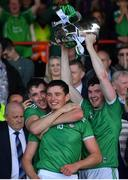 30 June 2019; Diarmaid Byrnes and Gearoid Hegarty of Limerick celebrate as captain Declan Hannon lifts the cup after the Munster GAA Hurling Senior Championship Final match between Limerick and Tipperary at LIT Gaelic Grounds in Limerick. Photo by Brendan Moran/Sportsfile