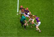 30 June 2019; Referee John Keenan throws in the ball to start the game between James Maher, left, and Cillian Buckley of Kilkenny and Lee Chin, left, and Diarmuid O'Keeffe of Wexford during the Leinster GAA Hurling Senior Championship Final match between Kilkenny and Wexford at Croke Park in Dublin. Photo by Daire Brennan/Sportsfile