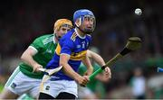 30 June 2019; John McGrath of Tipperary in action against Richie English of Limerick during the Munster GAA Hurling Senior Championship Final match between Limerick and Tipperary at LIT Gaelic Grounds in Limerick. Photo by Piaras Ó Mídheach/Sportsfile