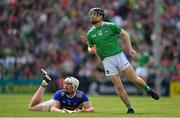 30 June 2019; Graeme Mulcahy of Limerick and Padraic Maher of Tipperary watch an effort of a point by Mulcahy during the Munster GAA Hurling Senior Championship Final match between Limerick and Tipperary at LIT Gaelic Grounds in Limerick. Photo by Brendan Moran/Sportsfile