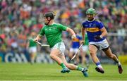 30 June 2019; Peter Casey of Limerick races clear of James Barry of Tipperary during the Munster GAA Hurling Senior Championship Final match between Limerick and Tipperary at LIT Gaelic Grounds in Limerick. Photo by Brendan Moran/Sportsfile