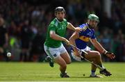 30 June 2019; Peter Casey of Limerick in action against James Barry of Tipperary during the Munster GAA Hurling Senior Championship Final match between Limerick and Tipperary at LIT Gaelic Grounds in Limerick. Photo by Brendan Moran/Sportsfile