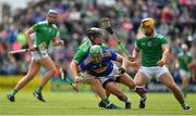 30 June 2019; James Barry of Tipperary is tackled by Peter Casey and Tom Morrissey of Limerick during the Munster GAA Hurling Senior Championship Final match between Limerick and Tipperary at LIT Gaelic Grounds in Limerick. Photo by Brendan Moran/Sportsfile