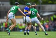 30 June 2019; John O'Dwyer of Tipperary is tackled by Gearóid Hegarty, left, and Declan Hannon of Limerick during the Munster GAA Hurling Senior Championship Final match between Limerick and Tipperary at LIT Gaelic Grounds in Limerick. Photo by Piaras Ó Mídheach/Sportsfile