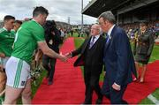30 June 2019; President Michael D Higgins is introduced to Limerick captain Declan Hannon by Liam Lenihan, Chairman of the Munster Council, prior to the Munster GAA Hurling Senior Championship Final match between Limerick and Tipperary at LIT Gaelic Grounds in Limerick. Photo by Brendan Moran/Sportsfile