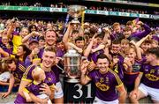 30 June 2019; Players from the winning Wexford minor and senior teams and their cup after the Leinster GAA Hurling Senior Championship Final match between Kilkenny and Wexford at Croke Park in Dublin. Photo by Ray McManus/Sportsfile