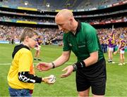 30 June 2019; Pictured is Brandon Burke, from Enable Ireland Children's Services presenting the match sliotar to referee John Keenan.  Enable Ireland, official charity partner of the GAA, at Croke Park for the Leinster Championship Hurling Final 2019. Photo by Ray McManus/Sportsfile