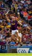 30 June 2019; Lee Chin of Wexford wins possession ahead of Paddy Deegan of Kilkenny during the Leinster GAA Hurling Senior Championship Final match between Kilkenny and Wexford at Croke Park in Dublin. Photo by Ray McManus/Sportsfile