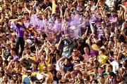30 June 2019; Wexford supporters, on Hill 16, celebrate after their side had scored a penalty during the Leinster GAA Hurling Senior Championship Final match between Kilkenny and Wexford at Croke Park in Dublin. Photo by Ray McManus/Sportsfile