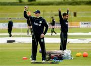 1 July 2019; Lorcan Tucker and Simi Singh warm up before the Men's Cricket 1st One Day International match between Ireland and Zimbabwe at Bready Cricket Club, in Magheramason, Tyrone. Photo by Oliver McVeigh/Sportsfile