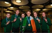 1 July 2019; Team Ireland boxers, from left, Regan Buckley, Michael Nevin, Michaela Walsh, Kurt Walker, Kellie Harrington and Gráinne Walsh with their medals on their return home from the Minsk 2019 European Games at Dublin Airport in Dublin. Photo by Eóin Noonan/Sportsfile