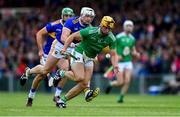 30 June 2019; Tom Morrissey of Limerick gets past James Barry, behind, and Pádraic Maher of Tipperary during the Munster GAA Hurling Senior Championship Final match between Limerick and Tipperary at LIT Gaelic Grounds in Limerick. Photo by Piaras Ó Mídheach/Sportsfile