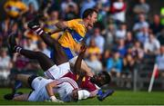 29 June 2019; David Tubridy of Clare celebrates after scoring his side's first goal of the game despite the efforts of Boidu Sayeh and Eoin Carberry of Westmeath during the GAA Football All-Ireland Senior Championship Round 3 match between Westmeath and Clare at TEG Cusack Park in Mullingar, Westmeath. Photo by Sam Barnes/Sportsfile