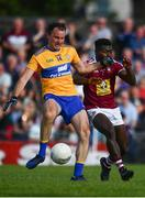29 June 2019; David Tubridy of Clare shoots to score his side's first goal of the game despite the efforts of Boidu Sayeh of Westmeath during the GAA Football All-Ireland Senior Championship Round 3 match between Westmeath and Clare at TEG Cusack Park in Mullingar, Westmeath. Photo by Sam Barnes/Sportsfile