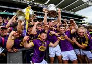 30 June 2019; The Wexford team celebrate with the winning Wexford minor team following the Leinster GAA Hurling Senior Championship Final match between Kilkenny and Wexford at Croke Park in Dublin. Photo by Ramsey Cardy/Sportsfile